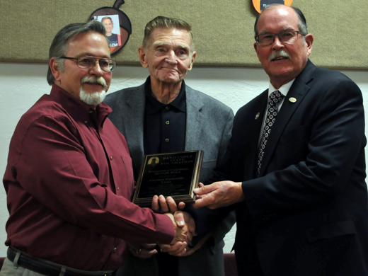 Kim Peterson presents Bob Burger of the Guymon Panhandle Lions with the Distinguished Contributor 