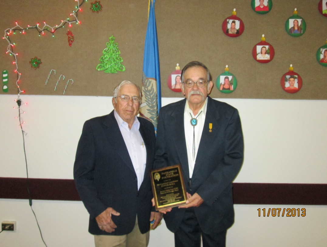 Leland Robertson presents the Distinguished Contributors Honor Roll plaque to Mr. Neal Cook of the Jordan-Quinn Post #1203 Veterans of Foreign Wars.