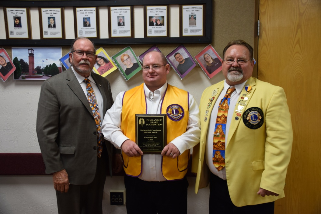 (Pictured l to r: Kim Peterson, Charles Michael III and Charles Michael Jr.)