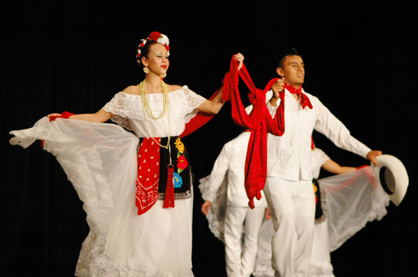 Using only their feet, Mendoza and Guadian tied a bow out of a length of red fabric.