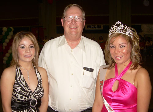 Oklahoma Panhandle State University President Dave Bryant was on hand last Sunday afternoon to crown Anaid Jesseline Gurrero (right) the Fiesta Queen. On the left is Karina Villalobos who was the runner-up.  Bryant also presented both young women with scholarships to OPSU. The fiesta is held annually at the Texas County Activity Center in Guymon.  - Scott Puryear photo