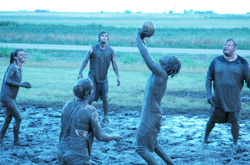 Students enjoy mud volleyball