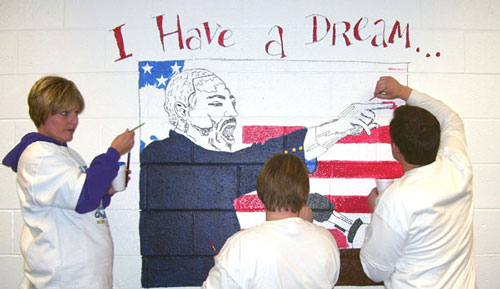 OPSU students paint a mural.