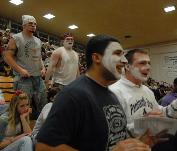 Members of the Aggie Football team cheer during the St. Edward's game last Saturday night