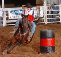 Jordan Muncy rounds a barrel at the Alva rdoeo