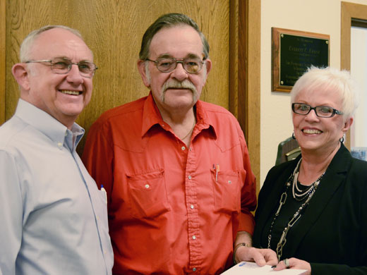 From left to right, Chet Kron and Neal Cook present a check to Dr. Doris Looper, the executive secretary for the Panhandle State Foundation, for a scholarship funded by the Guymon VFW post.—Laura Nelson photo