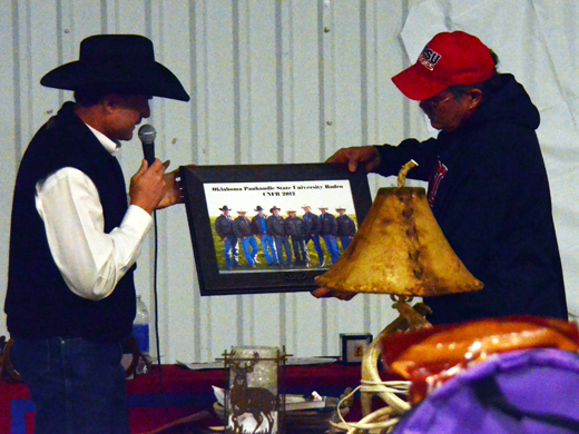 Head Rodeo Coach Craig Latham (left) presents 2012 Top Hand, Ken Peterson, with a framed photo of the 2012 College National Finals Rodeo Team-photo by Laycee Collins