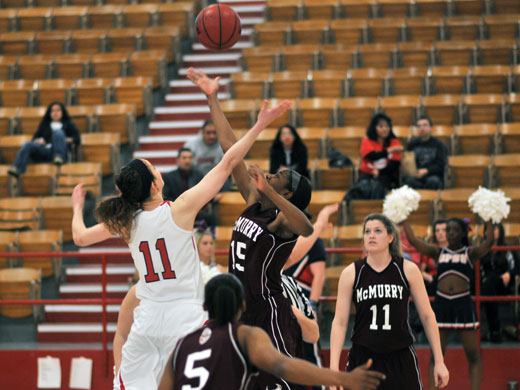 Meagan Bell jumps for the tip-off at the game against McMurry Friday afternoon.—Sara Koster photo