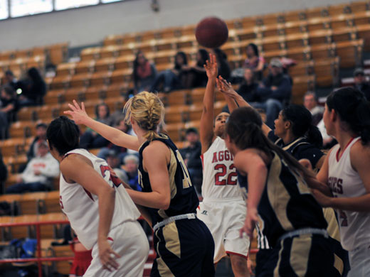 Senior Da'Veonna Munson goes up for two in heavy traffic in her final as an Aggie.—Sarah Koster photo
