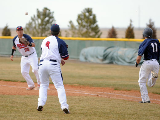 Pitcher Corey Mingin throws to first baseman Nick Crosswhite for an easy out during the second game of the doubleheader against UAFS.—Sarah Koster photo