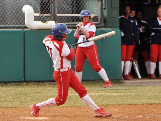 This is the 3-run homer swing by Emily Vasquez that started the Aggie scoring in their win over ENMU on Tuesday.—Laura Nelson photo