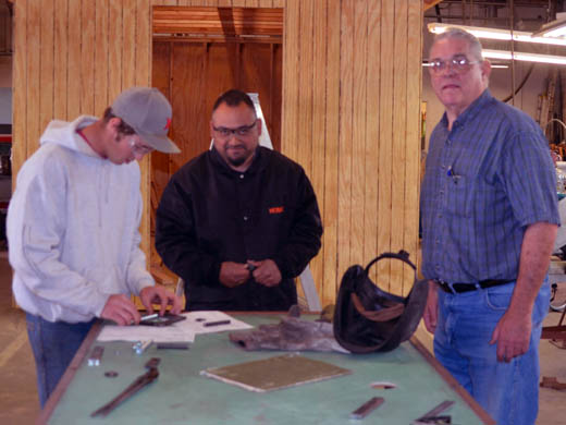 Larry Hough (right), pictured here working with students on a class project. —Photo by Danae Moore