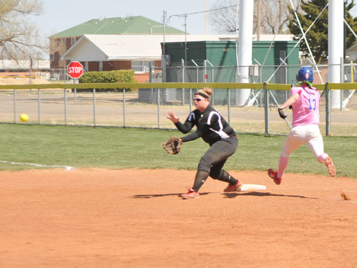 Krista Bomak beats the throw Wednesday afternoon.—Sage Fischer photo