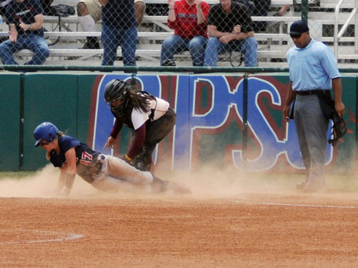 Britnie Weddle took advantage of an error to score the final OPSU run of the game on Saturday.—Justine Gaskamp photo