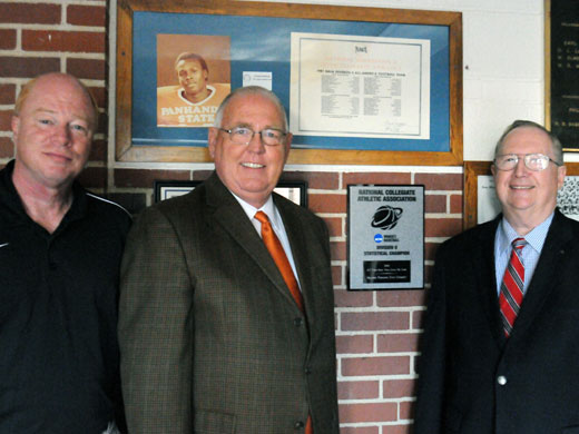Pictured here from left to right beside the plaque from the plaque received from the NCAA recognizing the 2011-2012 women's basketball team are head men's basketball coach Jerry Olson, athletic  director Dr. Wayne Stewart, and President Dave Bryant.—Laura Nelson photo