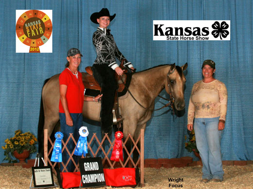 Pictured here are Jessica Johns and the 2012 Kansas State Fair 2-Year-Old Snaffle Bit Futurity Champion, OPSU Sparklin Gin. Also pictured are OPSU's Channing Hawks, far right, and Gena Henson of Hugoton, Kan.—Photo provided by Wright Focus Photography