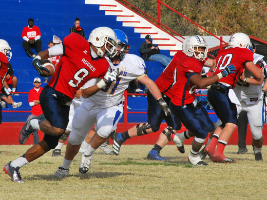 Nick Collins runs the ball during Saturday's game against Wayland Baptist University. —Kenton Schmidt photo