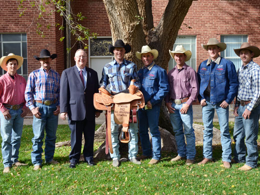 Pictured here are some of the members of the OPSU men's rodeo team that won first place at the NWOSU rodeo over the weekend with their coaches and OPSU President Dave Bryant. From left to right are Jake Watson; head coach Craig Latham; Bryant; men's all-around winner Joe Frost; assistant coach Robert Etbauer; Shade Etbauer; Caleb Bullock; and Allen Boore.—Justine Gaskamp photo