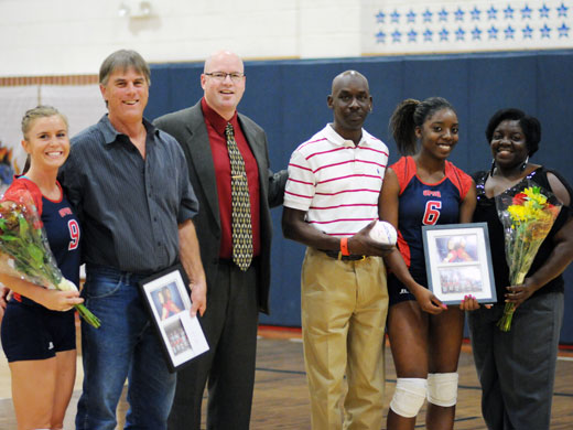 Pictured here are Alex Schmitt and her father Kevin, head coach Mike Stephens, and Michaela Redding and her parents, Michael Redding and Cathy Redding.—Sage Fischer photo