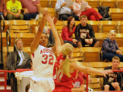 Sharice Papeleo led all scorers with 18 points in Saturday's game against Barclay College. In this photo, she is defended by Goodwell native and Barclay Bear Shandy Edenborough.Kelly Darnell photo