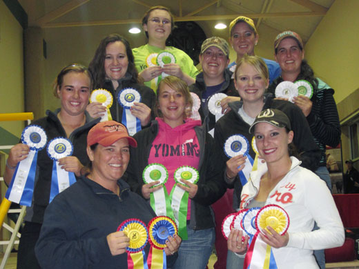 Displaying ribbons from the show in Lincoln are front row, left to right, Coach Channing Hawks and Madison Hughes; second row, left to right, Katy Doke, Kim Lee, and Lauren Harvey; third row left to right,  Leah Butts, Sarah Schultz, and Katy Doke; top row, left to right, Katie Clark and Misty Lethcho.—Courtesy photo
