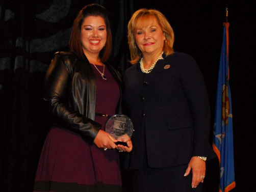 Panhandle State graduate Destyni Trayler (left) is pictured receiving the NexGen Under 30 award. —Courtesy photo