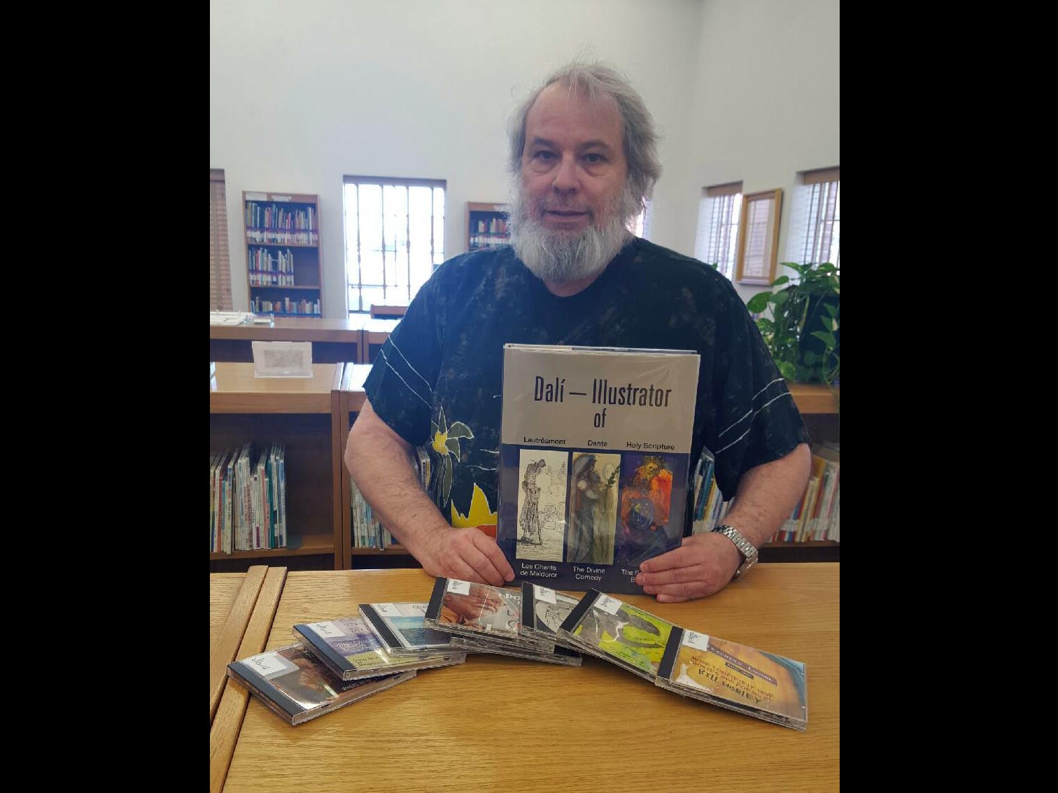 Library Director Tony Hardman is pictured here with some of the unique donations that McKee Library has received recently. —Courtesy photo