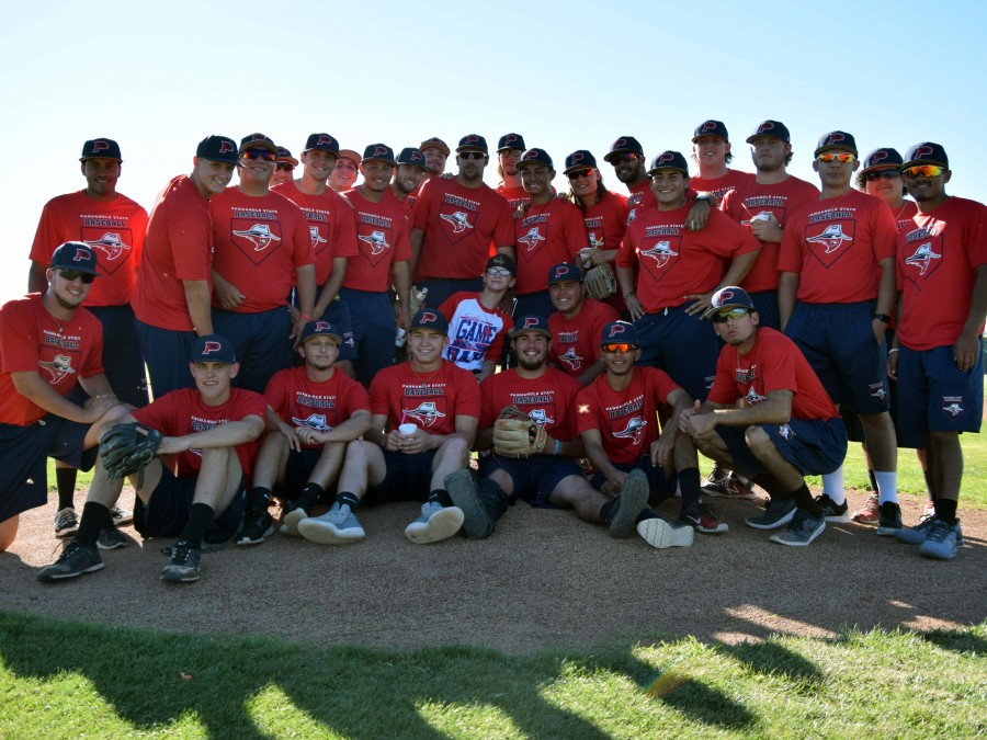 Panhandle State Baseball players gather around Austin Ronne after he threw out the first pitch at the Special Game Day on October 8 in Goodwell.—Photo by Alexis Faris