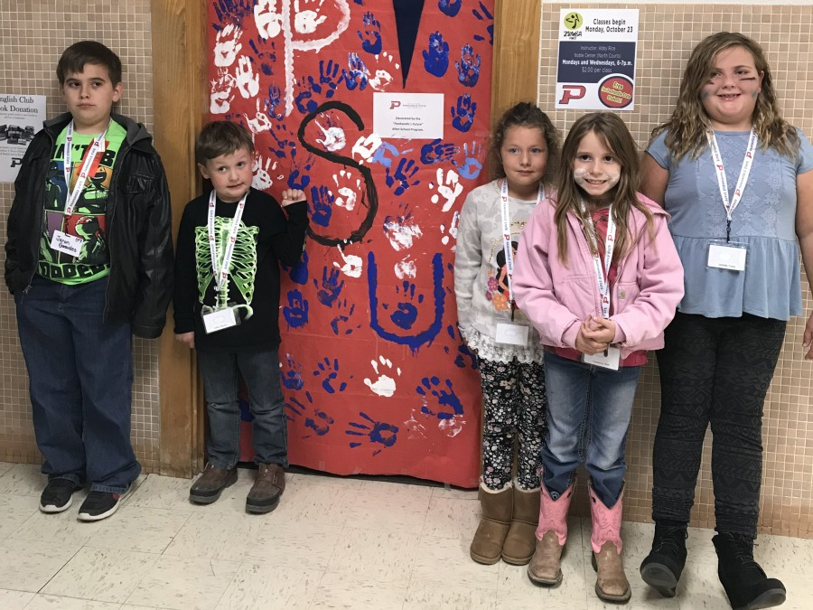 Students in Panhandle's Future, an afterschool program partnership with Goodwell Schools and Panhandle State, recently spread Aggie spirit with their door decorations during Homecoming Week. —Courtesy photo