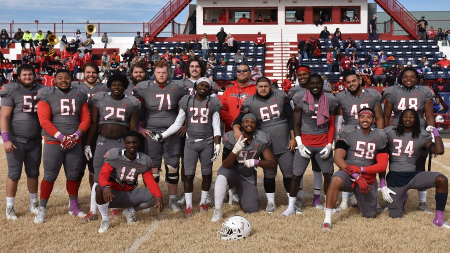 Seventeen seniors were recognized prior to Saturday's season finale football game against Texas Wesleyan. From back left: Mason Williams, Diego Arenas-Purvinas, Matthew Granz, Jakob Popple, Coach Gaskamp, Jermaine Wright; Front Standing from Left: Zach Perez-Clack, Preston Baker, Cullin Oliver, Marcus McCants, Cris Perez, Cedric Agyeman, Dominick Bell, Kameron Lyons; Front Kneeling from Left: Nick Shields, Charles Stone, David Smith and Linden Robertson.-Sarah Brady photo
