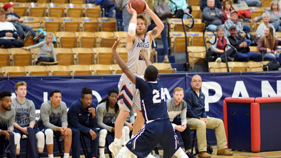 Senior Tyler Pate had a good opening game for the Aggies, scoring 14 points against Manhattan Christian College.-Danae Moore photo