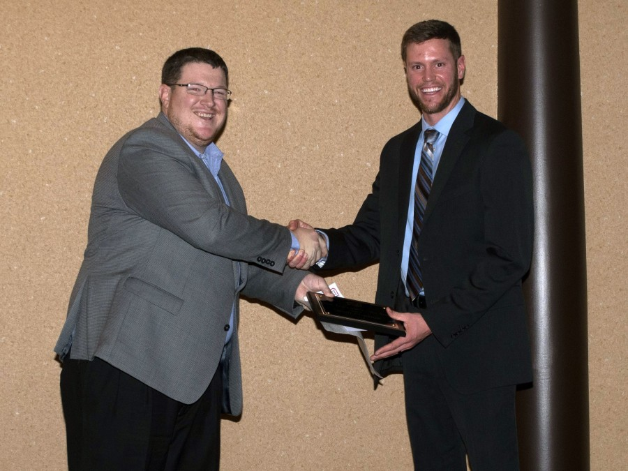 Josh Gordon (right) received the Outstanding New Agronomist award among Crop Specialists at Servi-Tech where he is currently employed. —Courtesy photo