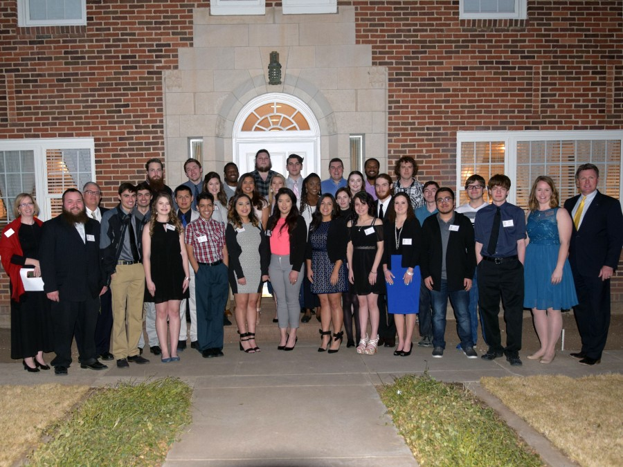 Members of the campus organizations AITP and PBL along with their faculty advisors and President Dr. Tim Faltyn gather for a photo before the second annual Perfect Pairings hosted at the University House. —Photo by Danae Moore
