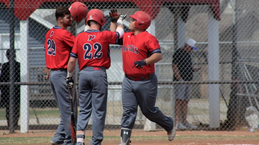 The Aggies celebrate after a home run hit by Luis Rodriguez at Central Christian.-Courtesy photo