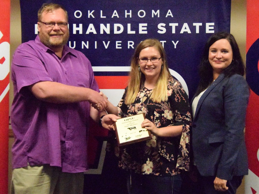 Tyler Meyeres (center) was named the Outstanding Agronomy Department student. She is pictured here with Agronomy Department Head Dr. Curtis Bensch (left) and Vice President of Academic and Student Affairs Dr. Julie Dinger (right). —Photo by Taylor Jacobson