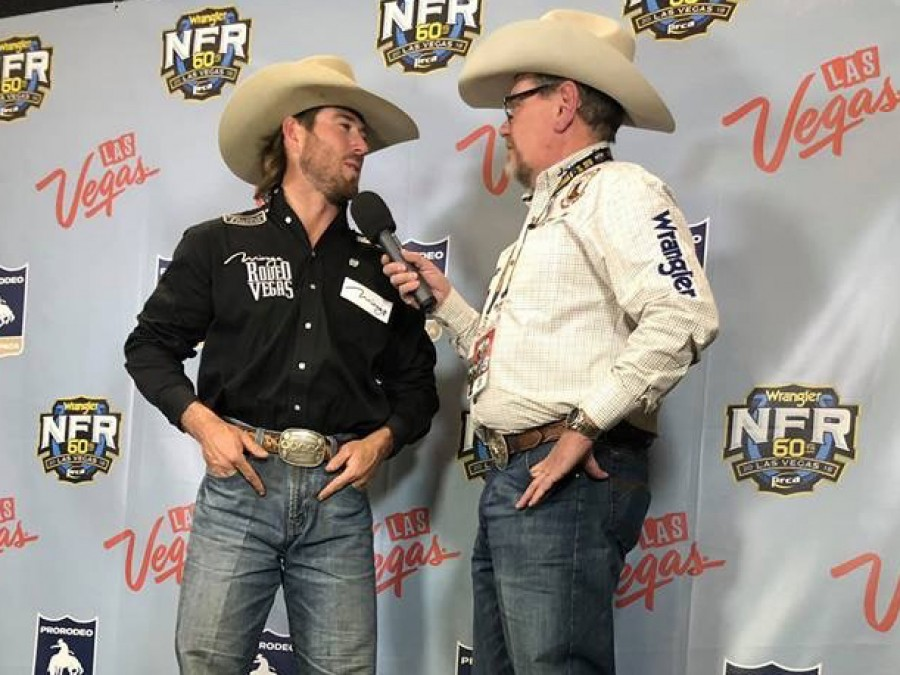 Panhandle State graduate and former Rodeo team member Cort Scheer (left) stops for an interview with Voice of the Aggies Derek Barton after claiming the top spot of the saddle bronc riding for the second night in a row on Friday, December 7, 2018. —Courtesy photo