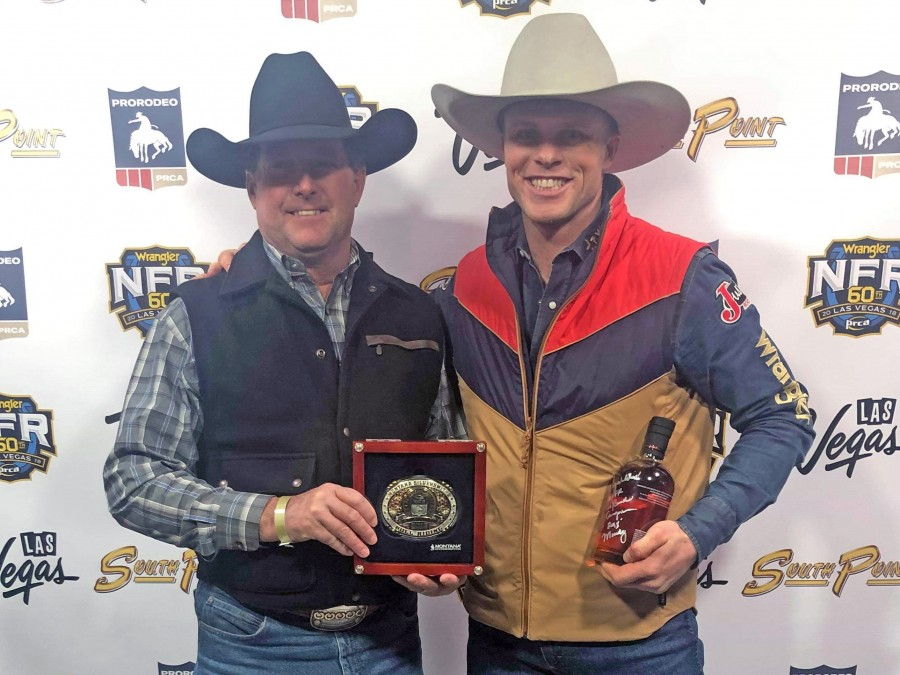 Joe Frost (right) is all smiles as he pauses for a photo with former Panhandle State Rodeo Coach and one of Frost's biggest influences Craig Latham after his win in round 8 at the NFR. —Courtesy photo