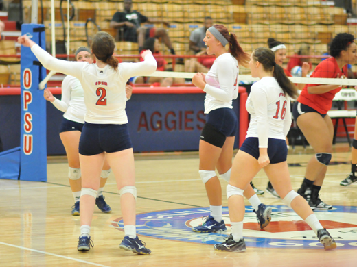 Aggie volleyball celebrates winning their way into the Championship Match of the Aggies Challenge Tournament.—Sage Fisher Photo