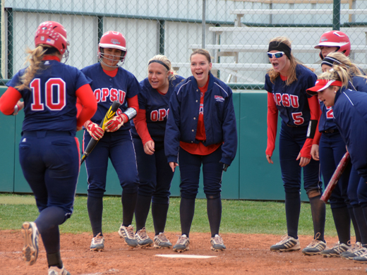 The Aggies celebrate as Madison Heathington crosses home plate off her second homerun of their four-game series against UTPB.—Sarah Henderson photo