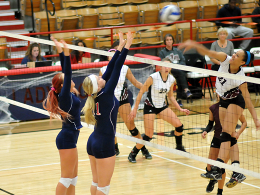 Sarah Koster and Jessica DeBaun go up for a block against McMurry.—Sage Fischer photo