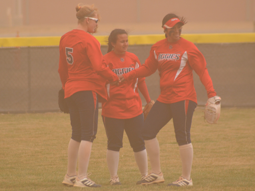 The Aggie outfielders had a lot to contend with in Tuesday's gusty game against Cameron.—Danae Moore photo