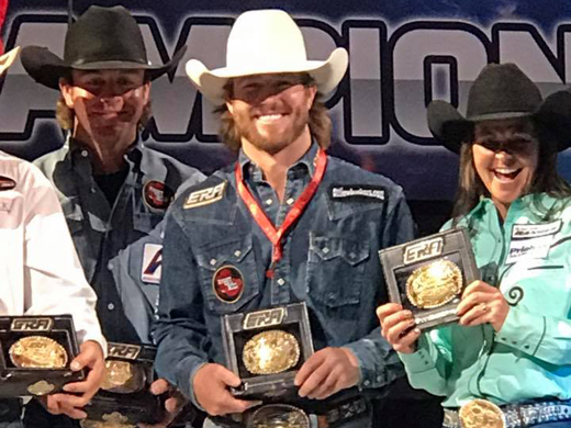Panhandle State graduate and former Rodeo team member Cort Scheer (center) won the saddle bronc riding title during the inaugural Elite Rodeo Athletes (ERA) World Championship. —Photo courtesy of Kema Scheer